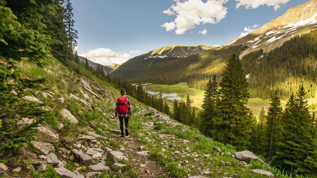 girl walking on trail in silverton colorado