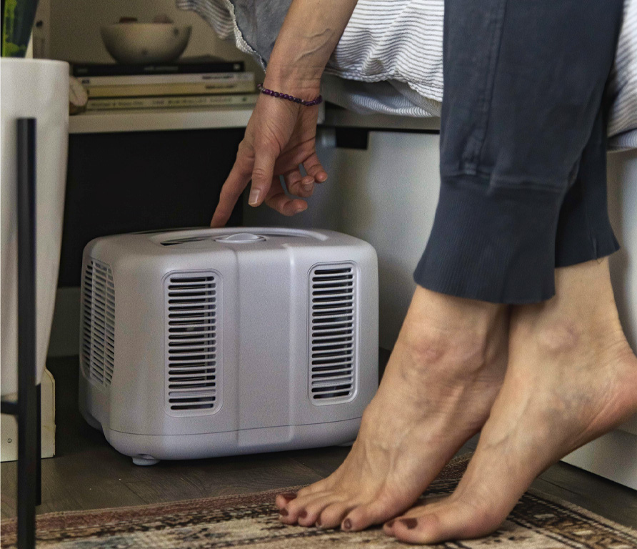 woman adjusting her chilipad cooling system