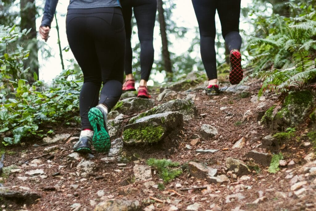 Group of women trail running photo from the waist down